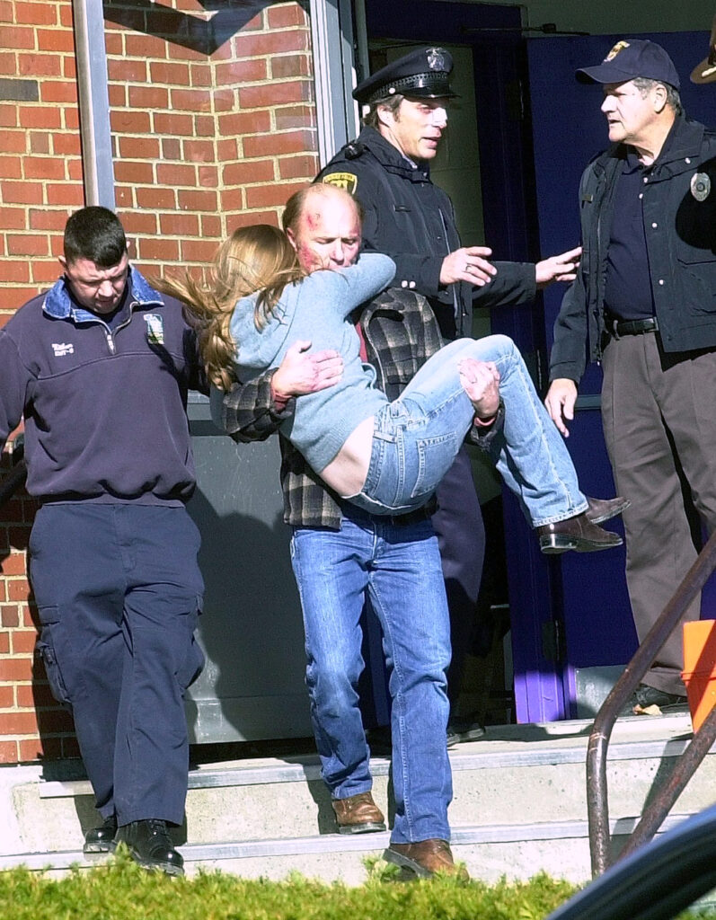 "Actor Ed Harris carries a girl out of Waterville High School, where a shooting scene in the ""Empire Falls"" movie was filmed in 2003. Behind Harris is actor William Fichtner, who played a police officer in the 2005 TV movie miniseries filmed throughout central Maine. Harris has pledged $75,000 for the future Paul J. Schupf Art Center being planned for 93 Main St. in downtown Waterville."