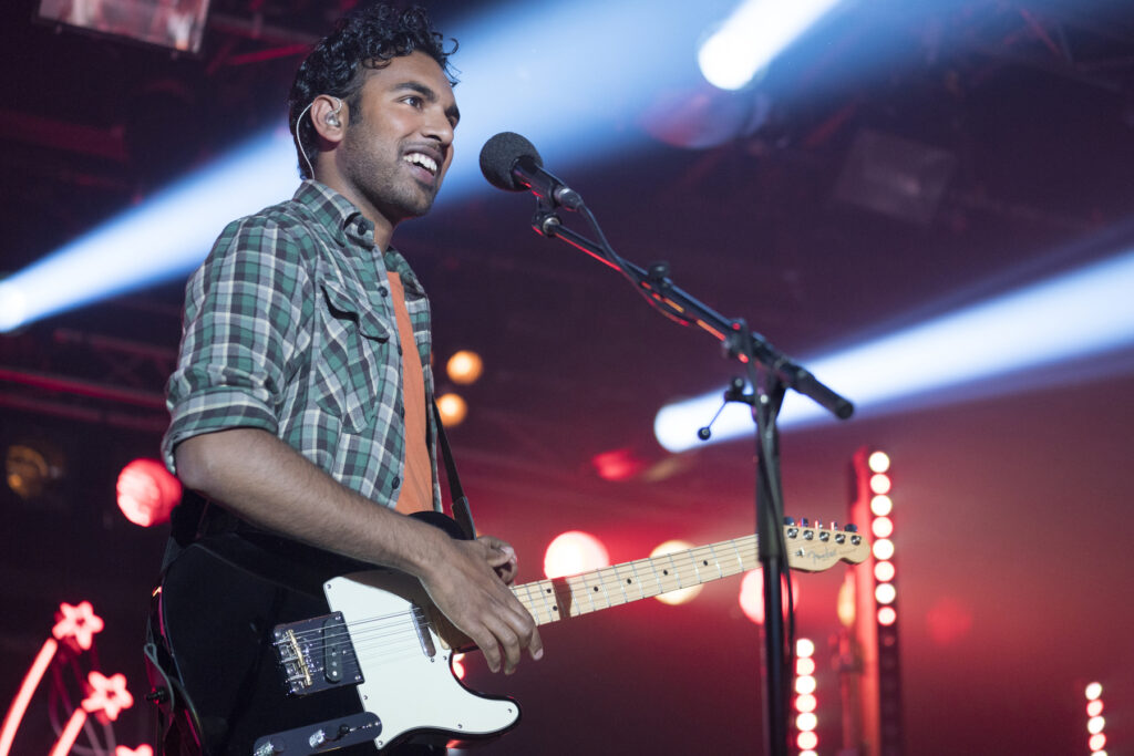 """This image released by Universal Pictures shows Himesh Patel in a scene from """"Yesterday."""""""