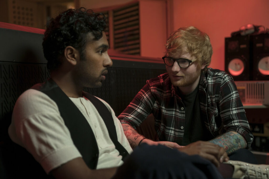 """This image released by Universal Pictures shows Himesh Patel, left, and Ed Sheeran in a scene from """"Yesterday."""""""