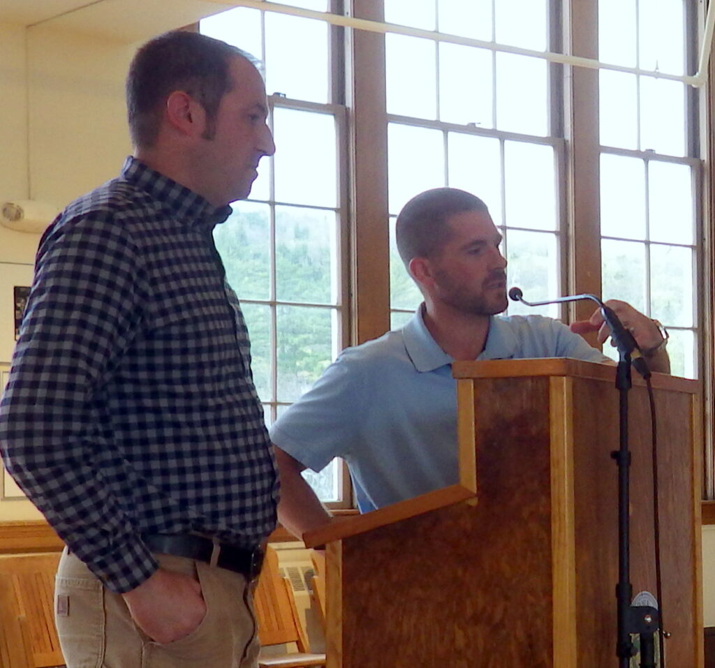 Engineers Nate Gustafson, left, and Travis Noyes of engineering firm CES Inc. of Brewer, discuss construction repairs at a meeting of the town's Board of Selectmen in October 2019. CES has acquired a small engineering firm in Massachusetts.