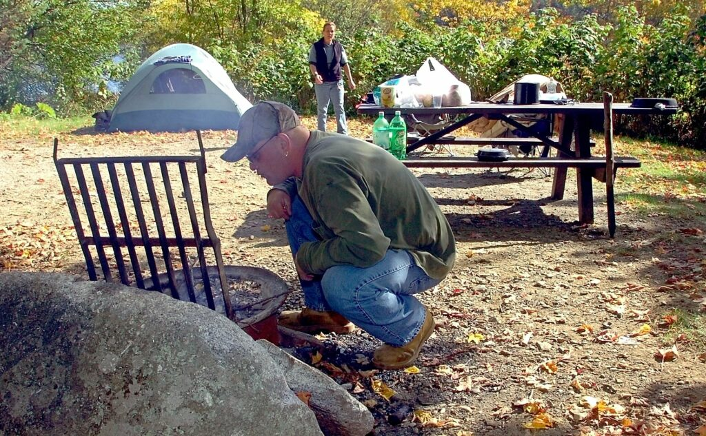 Lance and Donna Woodward prepare to cook lunch on a fire at their campsite at Lake St. George State Park in Liberty, where they had been camping for a week in 2015.