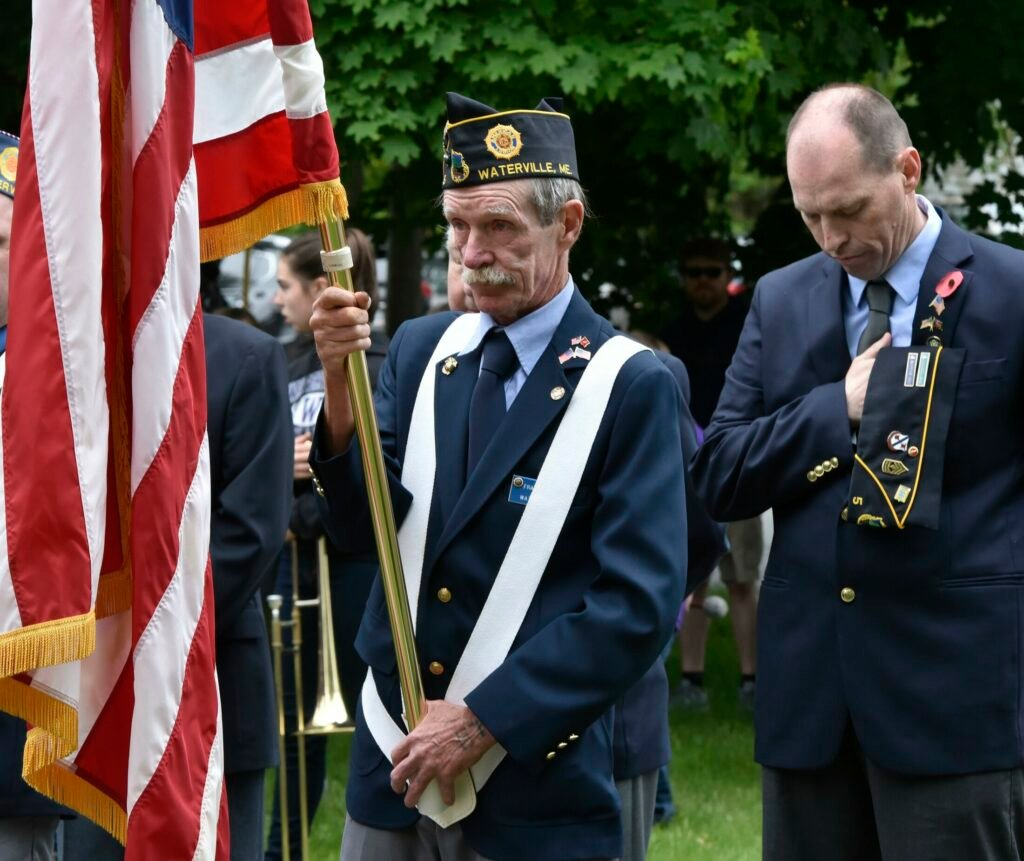 American Legion color guard members Frank McAdoo, left, and Craig Bailey take part in a Memorial Day ceremony on May 28, 2018, at Veterans Park in Waterville.