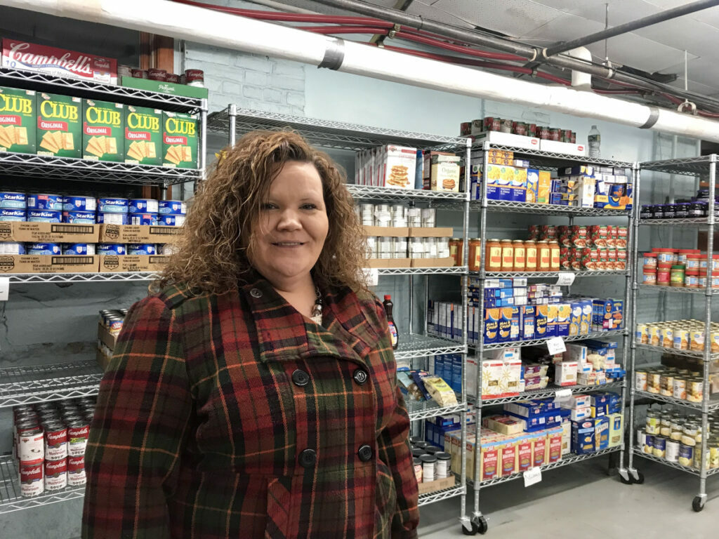 Board Chairwoman Shannon Drury, pictured here in January at the People Who Care Food Cupboard in Madison, has resigned. She had been criticized during her tenure for receiving a stipend.