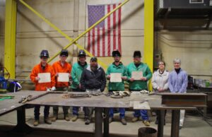 Successful welding program students (from left) Kurtis Polisky and Dustin Paine stand with Bancroft welding instructor Fred Locke, Bancroft project manager Kyle Lamb, fellow students Ryan Stuart and Christopher Willey, Patti Saarinen with the WMCA, and Oxford Hills/Nezinscot Adult Education director Tina Christophersen.