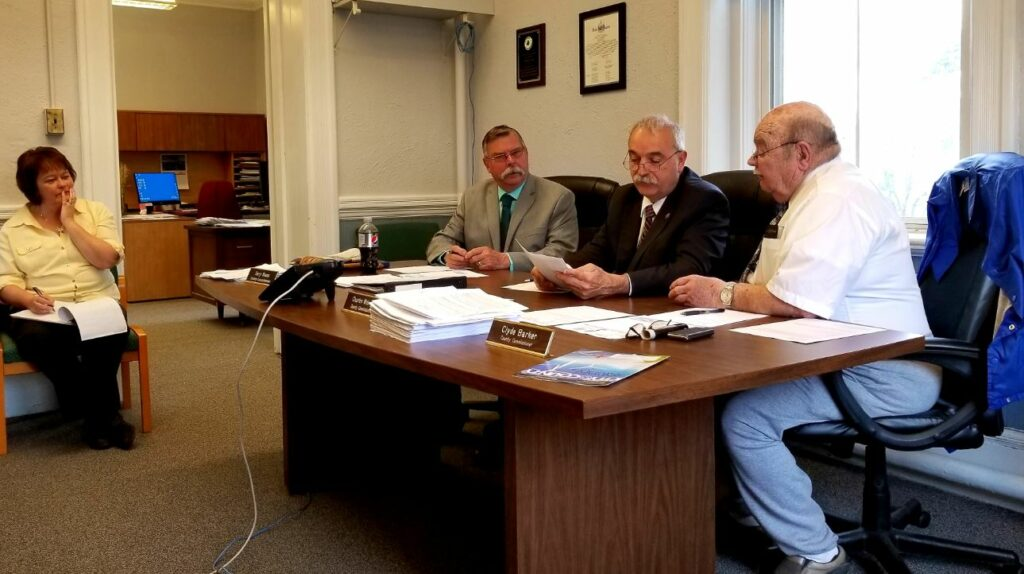 Franklin County commissioners meet with Finance Manager Vickie Braley at the courthouse in Farmington. From left are Chairman Terry Brann of Wilton, Charles Webster of Farmington and Clyde Barker of Strong.