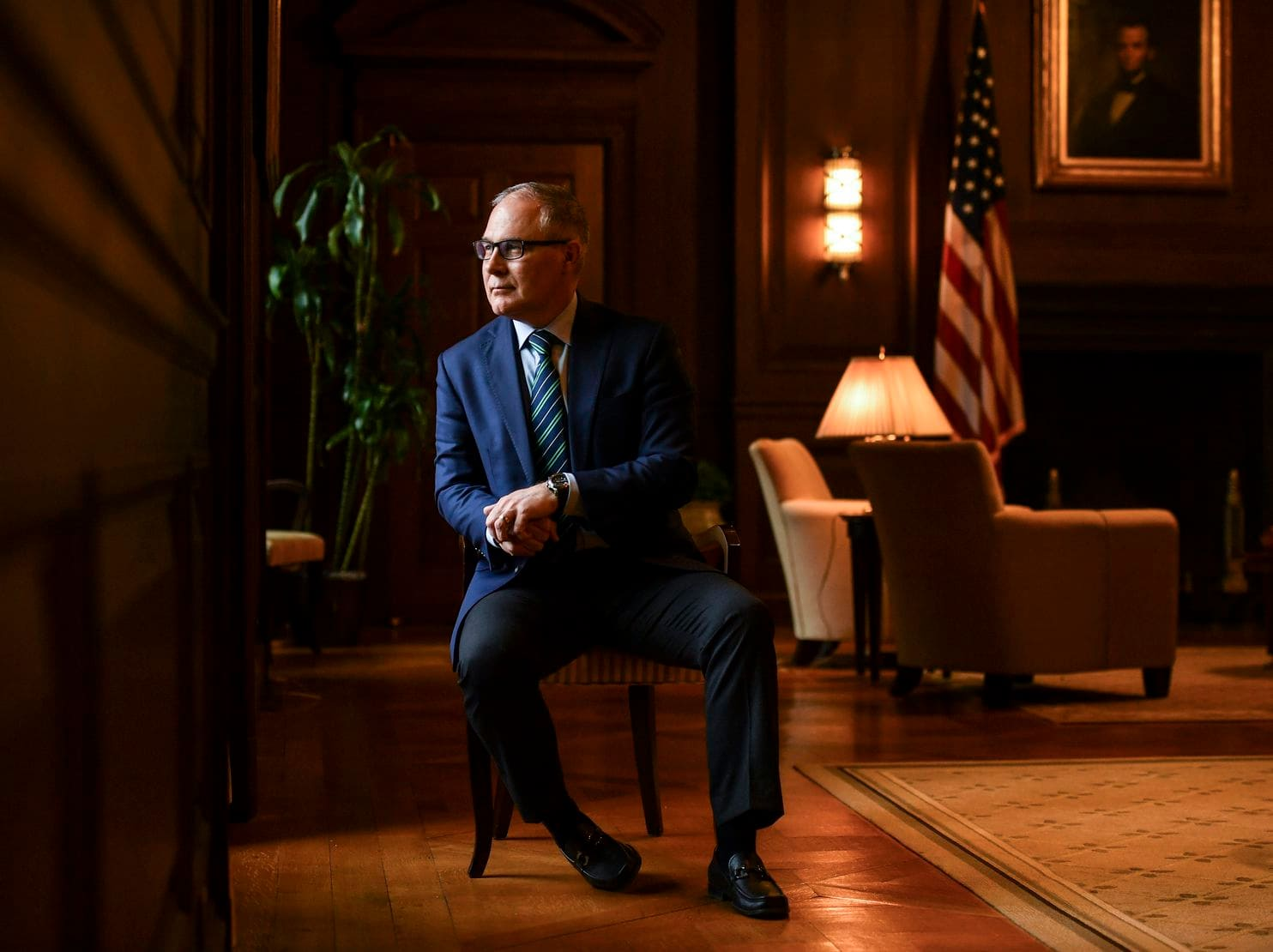 The Environmental Protection Agency watchdog suggests trying to recover some of the money spent by former EPA administrator Scott Pruitt, shown in his office at EPA headquarters, for travel.