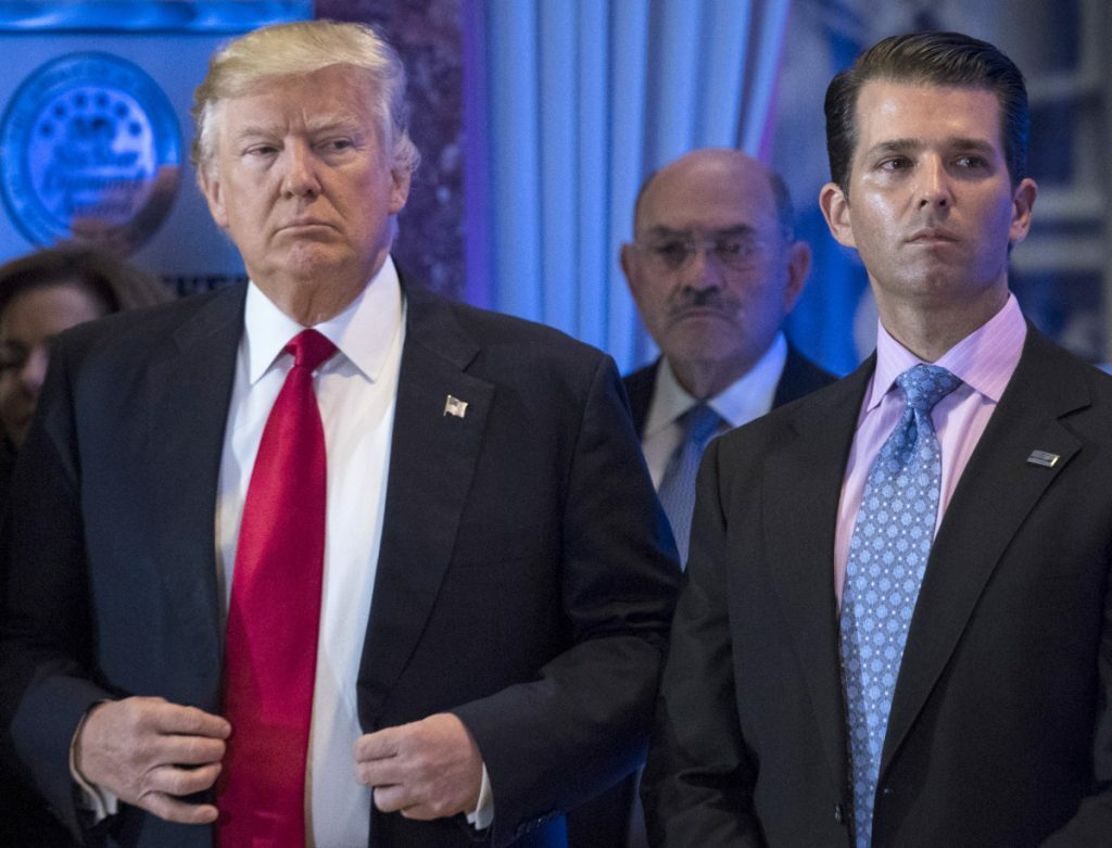 President Trump appears with Donald Trump Jr. in 2018. The Senate Intelligence Committee has subpoenaed Trump Jr. as part of its investigation into Russia's interference in the 2016 U.S. presidential election.
