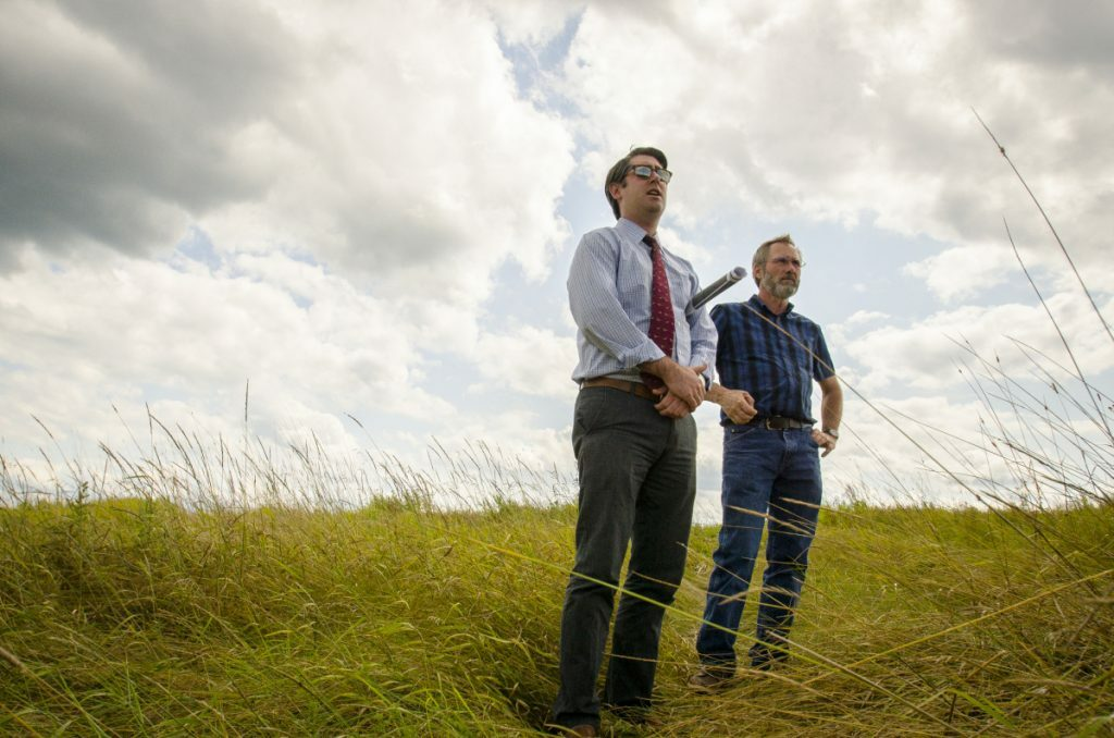 Garvan Donegan, Central Maine Growth Council senior economic development specialist, left, and Greg Brown, former Waterville city engineer, survey the landfill off Webb Road in Waterville in August 2017, where plans to site a solar farm came to fruition. The City Council will take the first vote Tuesday on approving leases with the developer for the city's landfill and the former Runser property.
