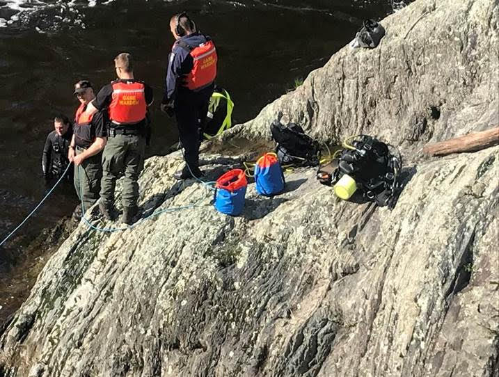 Maine Warden Service Dive Team members assist a diver who recovered the body of a 41-year-old man who fell into the Kenduskeag Stream in Bangor.