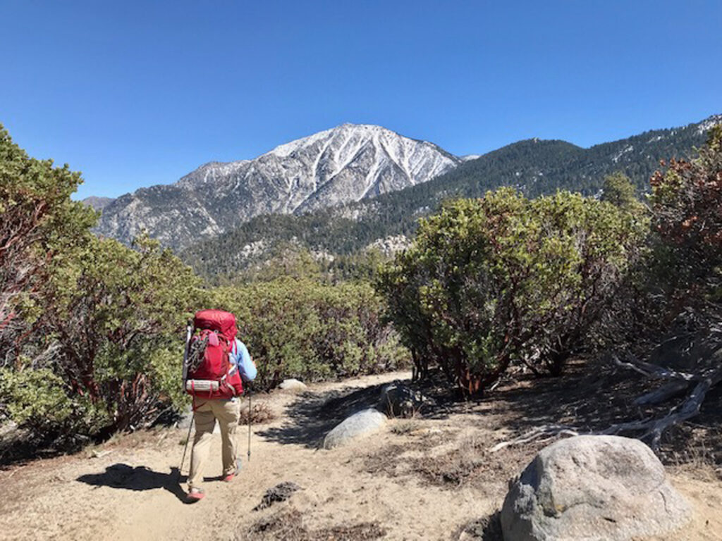 A Pacific Trail hiker descends the trail on snowy 10,800-foot Mt. San Jacinto.