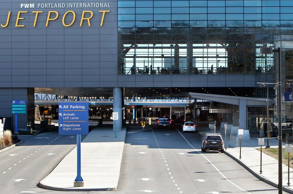 The city settled a lawsuit with two former workers at the Portland International Jetport who alleged they were the targets of age discrimination.