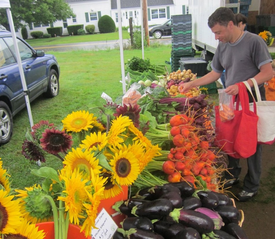 """Customers shop at the Crystal Spring Farmers' Market. The market is one of 30 in the state that now exchanges SNAP benefits for """"Harvest Bucks,"""" which work to provide more low-income families access to fresh, local produce."""
