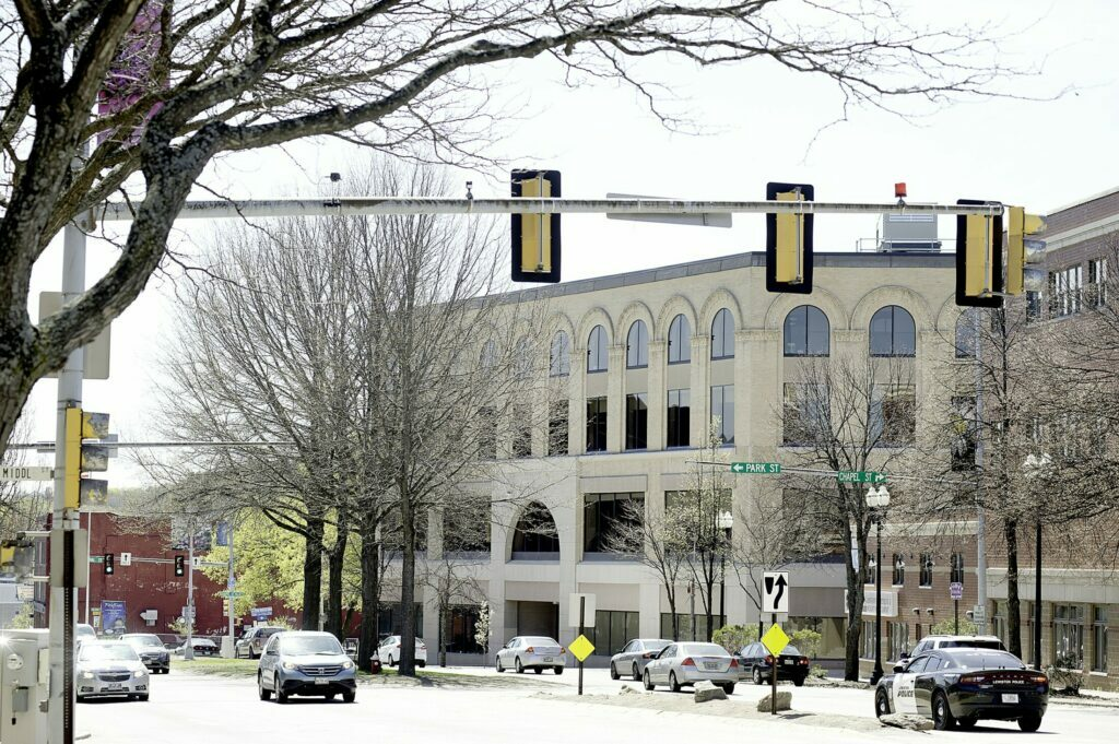 Once an upscale department store, the Peck building in Lewiston now houses a customer service center for L.L. Bean. Auburn Mayor Jason Levesque recently bought the building on Main Street for $5.5 million.