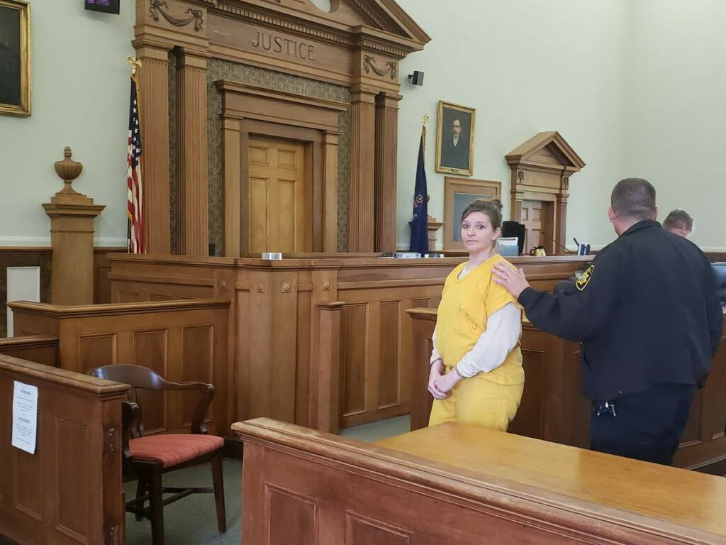 Sarah Richards is led out of the courtroom after pleading not guilty to murder in May.