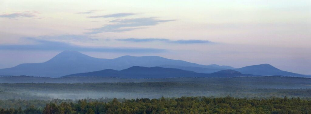 PATTEN, ME - July 15: Early morning haze colors Mount Katahdin and its surrounding mountains on Tuesday, July 15, 2014, seen from a height of land along Route 11 in Patten. The viewpoint is part of the Katahdin Woods & Waters scenic byway. (Photo by Gregory Rec/Staff Photographer)