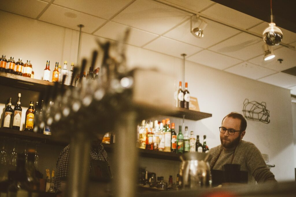 Andrew Volk, shown here tending bar at Portland Hunt + Alpine Club, hopes to get city approval for outdoor seating in a parking space.