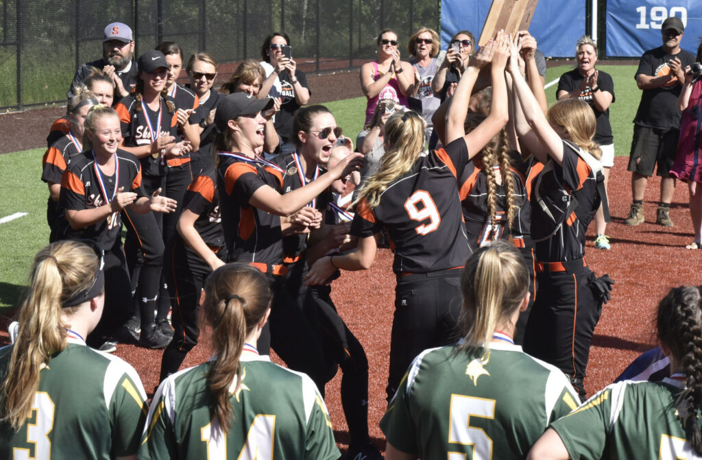 Members of the Skowhegan softball team celebrate after they defeated  Oxford Hills in the Class A North title game Wednesday at Colby College.