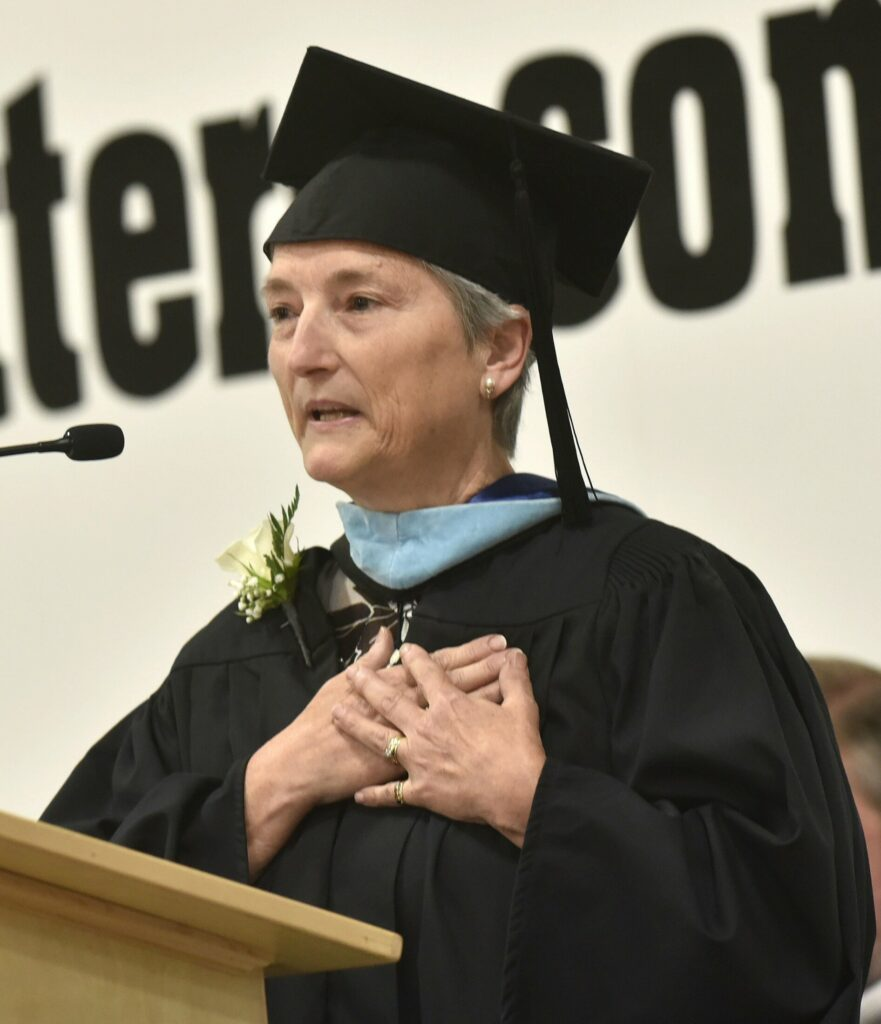 Long time Maine Central Institute teacher Tanya Kingsbury gives a commencement address  Sunday to the graduating class during the school's 150th commencement in Pittsfield.