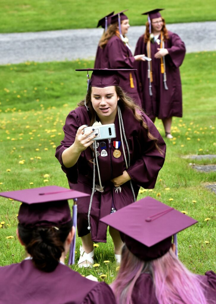 Maine Central Institute senior Macy Basford photographs fellow seniors before the school's 150th commencement Sunday in Pittsfield.