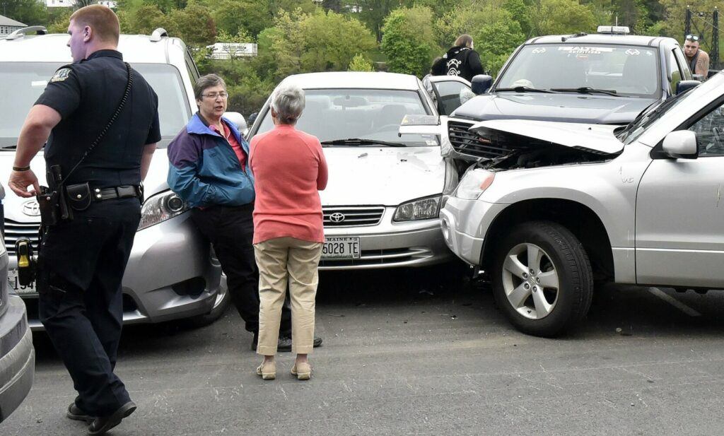Waterville police, fire and ambulance personnel were sent to RiverWalk at Head of Falls in Waterville on Sunday after the driver of the vehicle at right plowed into four vehicles parked for a Central Maine Pride event.