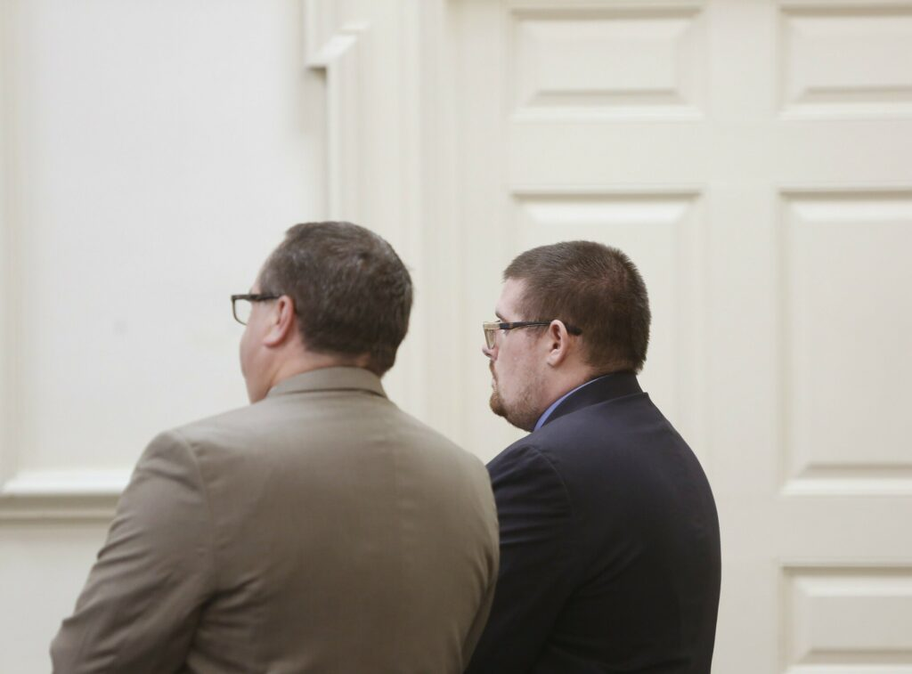Dustin Bentley, right, appears in court with his lawyer Robert LeBrasseur on Monday. He is accused of killing his roomate in Old Orchard Beach in March.