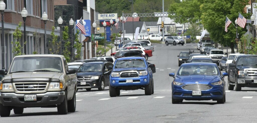 One-way traffic moves through downtown Waterville on June 5 on Main Street. At a meeting Wednesday intended to draw public input, state Department of Transportation Highway program officials will explain plans to turn the street into a two-way street.