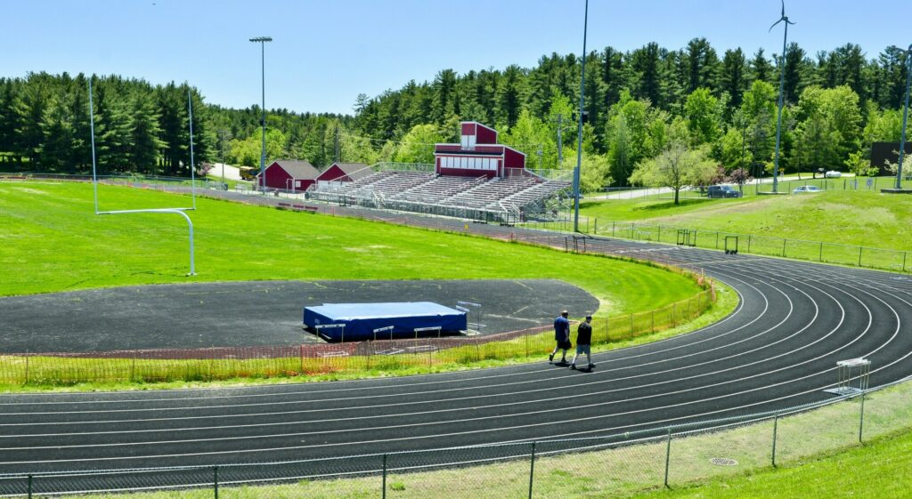 This photo, taken Friday, shows two walkers on the Taylor Harmon Track at Cony High's Alumni Field complex in Augusta.