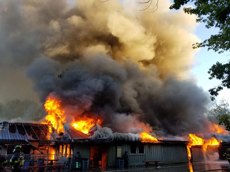 Firefighters battle the blaze Tuesday night at Bayley's Camping Resort in Scaborough.