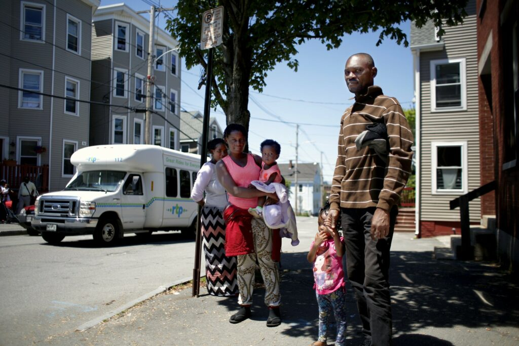 Mbemba Rey stands with family members on Chestnut Street outside the City of Portland Family Shelter on Wednesday. Rey, who does not speak English, was hesitant to share his story with a French-speaking reporter, but said he is originally from the Democratic Republic of Congo, and traveled through Central America to reach the United States. Rey said he arrived in Portland on Tuesday.
