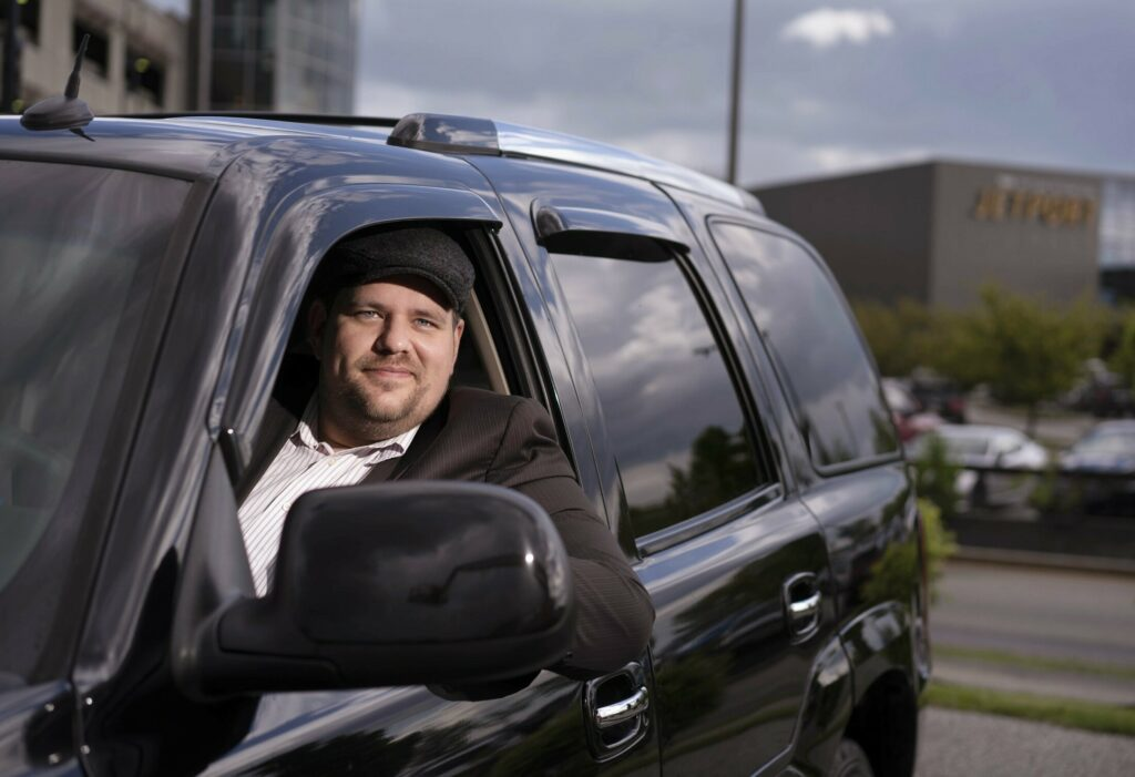 Uber driver Russell Purinton says the regulations the Portland International Jetport is imposing should be manageable for ride-share drivers. Purinton has been driving for Uber for four years.