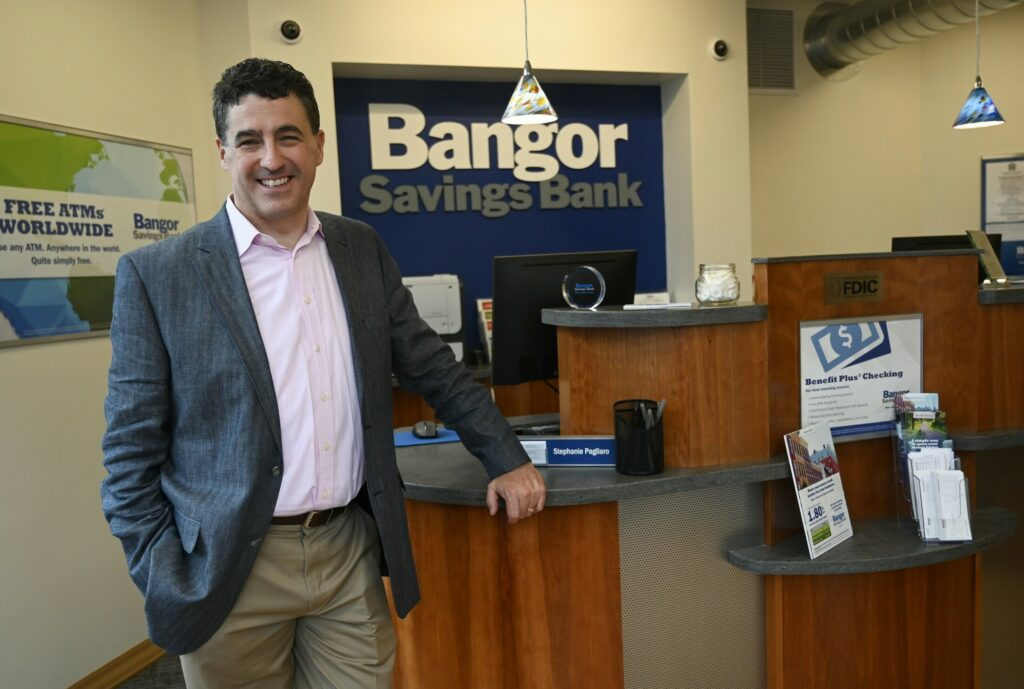 Bangor Savings President and CEO Bob Montgomery-Rice stands in the lobby of Bangor Savings' new Portsmouth, New Hampshire, location. Maine banks are expanding into New Hampshire for more business opportunities.