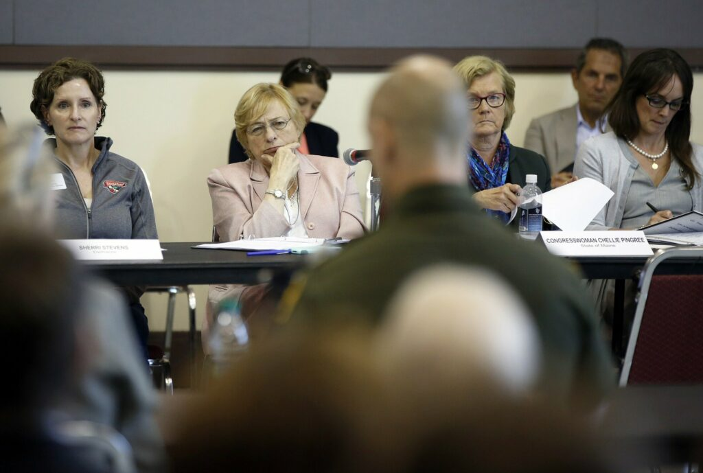 Gov. Janet Mills, center, U.S. Rep. Chellie Pingree, to her left, and others listen to Jason Owens of the U.S. Border Patrol during Friday's meeting to discuss the asylum-seeker surge into Portland.
