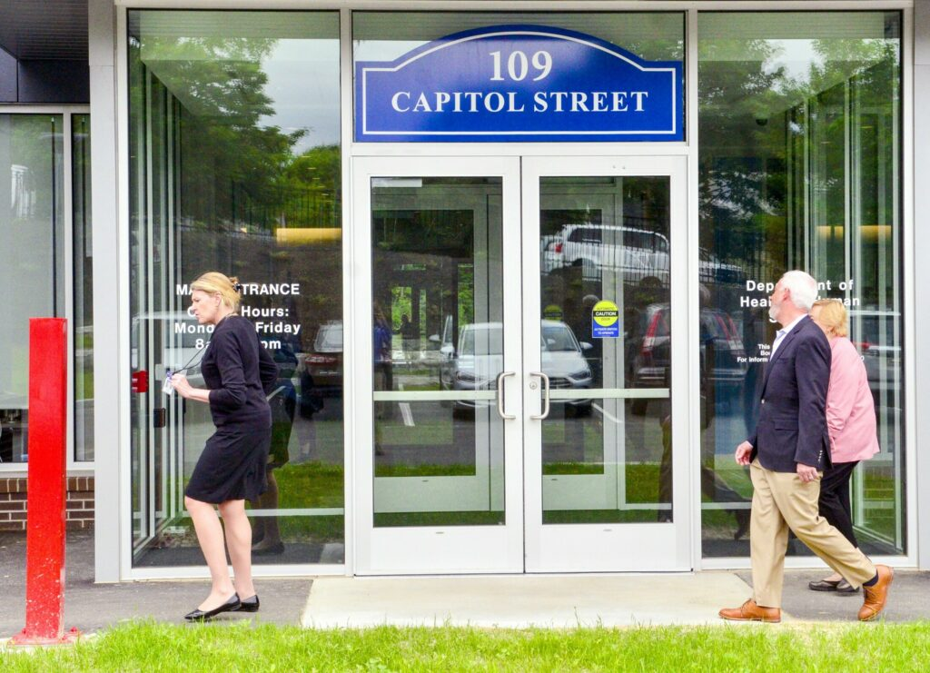 Jeanne Lambrew, commissioner of the Department of Health and Human Services, left, enters the new Maine state office building at 109 Capital St. in Augusta. The building will be offices for more than 500 employees of the Department of Health and Human Services and Department of Administrative and Financial Services.