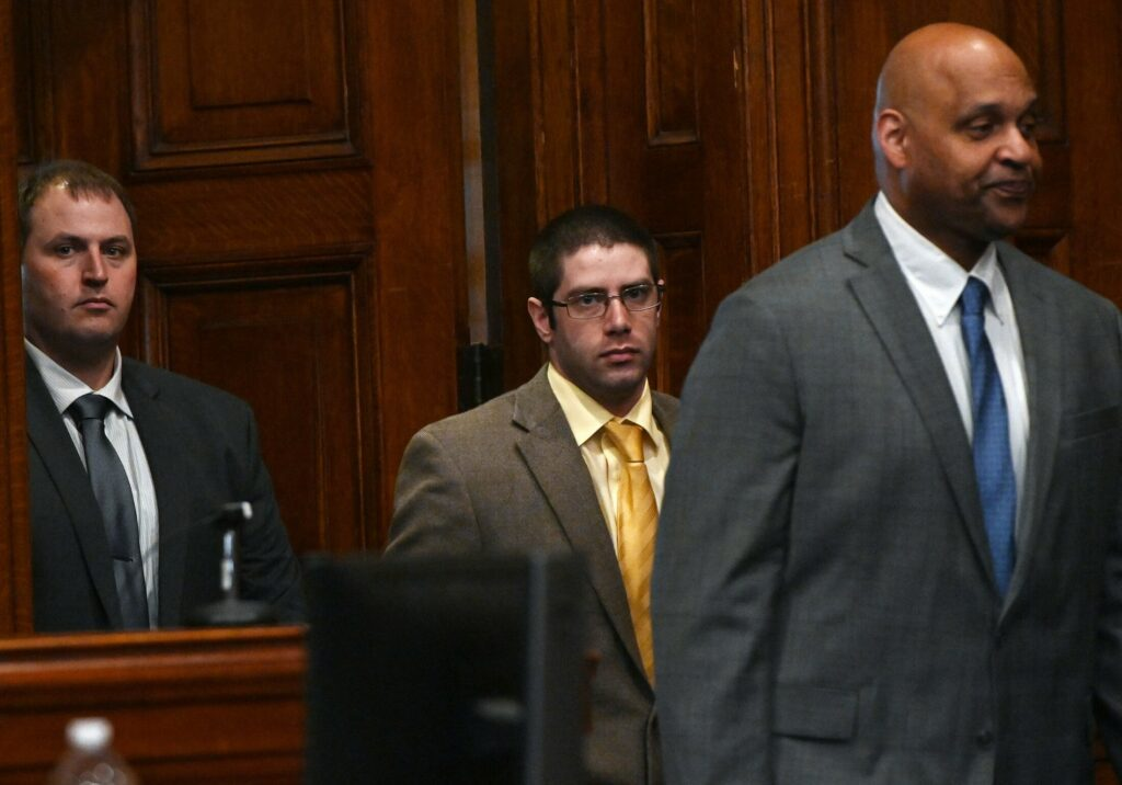 John D. Williams, center, is led into a Cumberland County courtroom for closing arguments in his murder trial Tuesday.