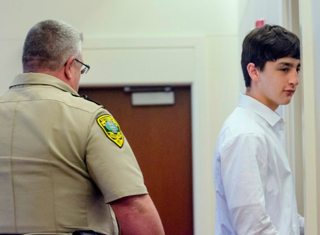A Kennebec Country sheriff's deputy escorts William Smith, one of three teens charged in the April 2018 death of Kimberly Mironovas, out of the courtroom June 19 at the Capital Judicial Center in Augusta during a break.