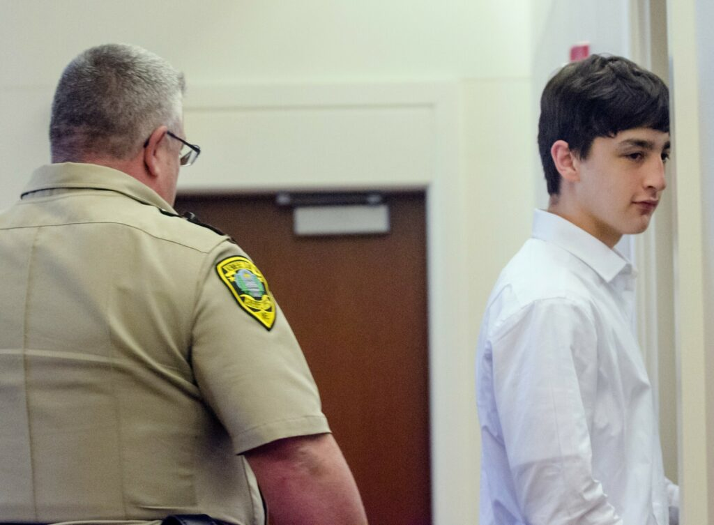 A Kennebec Country sheriff's deputy escorts William Smith, one of three teens charged in the April 2018 death of Kimberly Mironovas, out of the courtroom June 19 at the Capital Judicial Center in Augusta during a break in a hearing to determine whether to charge Smith as an adult.