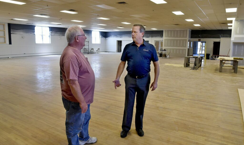 Bill Mitchell, right, speaking with property manager Jay Conway on June 24, will have an open house Sept. 12 at The Elm to show off the renovations that have been made to the former American Legion Hall.