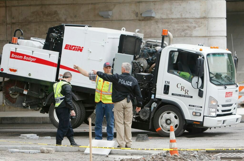 Police reconstruct the events that led to a construction worker being killed by a  street sweeping vehicle on Main Street in Yarmouth on Friday.