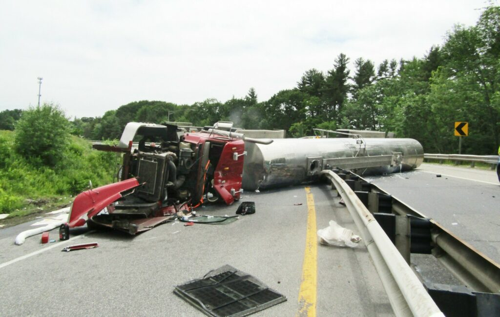 A tanker truck hauling milk overturned as it was exiting the Maine Turnpike in Falmouth on Thursday afternoon. The wreck blocked the southbound exit that leads to the Falmouth Spur at mile 52.