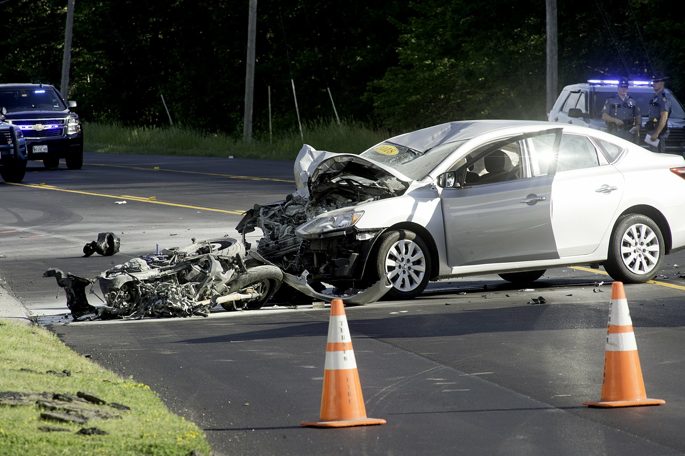 One person dead after car collides with motorcycles in