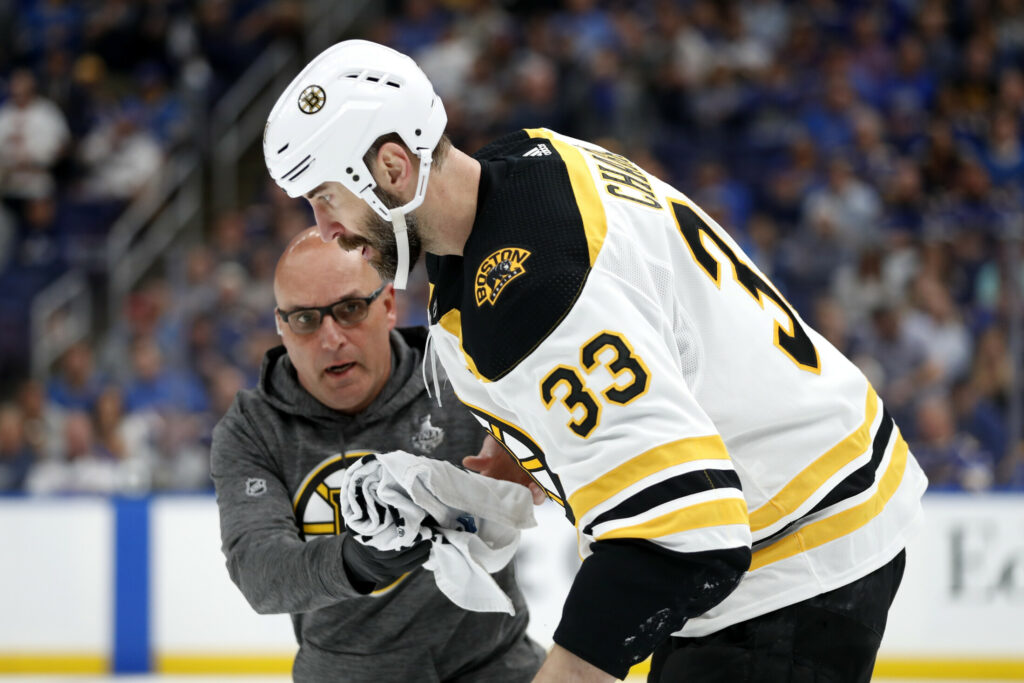 11afabce2 Boston Bruins defenseman Zdeno Chara leaves the ice after being hit in the  face with a