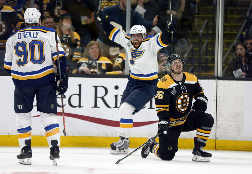 David Perron of the Blues celebrates his third-period goal behind Boston's Noel Acciari on Thursday night in Boston. Acciari was taken down by Tyler Bozak earlier on the play, but no penalty was called.