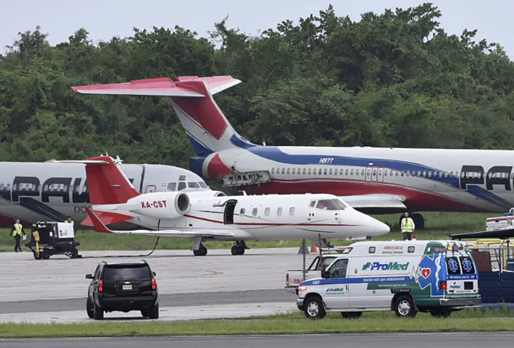 The ambulance carrying David Ortiz arrives to transfer him to the small ambulance plane parked at Las Americas Airport in Santo Domingo, Dominican Republic, for Monday's flight to Boston. Doctors removed Ortiz's gallbladder and part of his intestine after he was ambushed by a gunman at a bar in his native Dominican Republic.