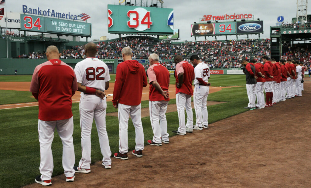 The Boston Red Sox and fans pause for a moment before Monday night's game for David Ortiz.