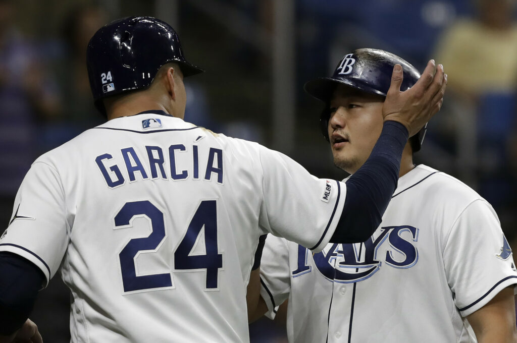 Tampa Bay's Ji-Man Choi, right, celebrates with Avisail Garcia after hitting a two-run home run off Oakland Athletics relief pitcher Joakim Soria in the eighth inning of the Rays' 6-2 win Monday in St. Petersburg, Florida.