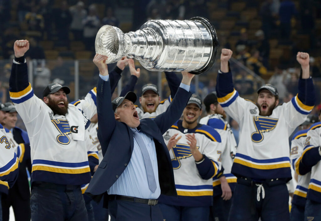 St. Louis Blues Coach Craig Berube carries the Stanley Cup after the Blues defeated the Boston Bruins in Game 7.