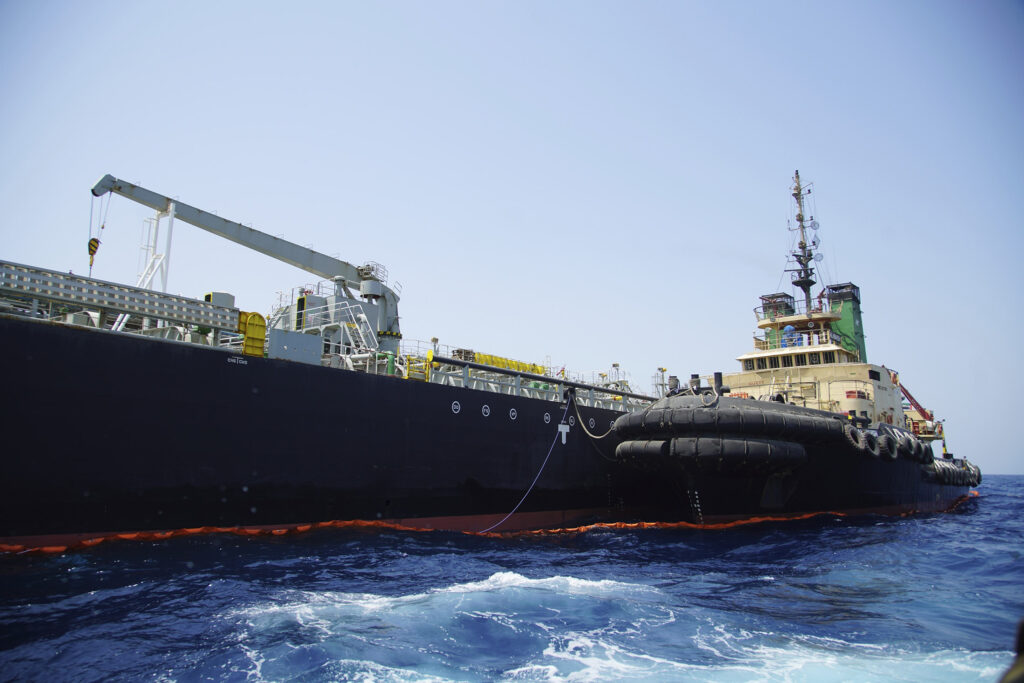 "The Japanese-owned oil tanker Kokuka Courageous, which the U.S. Navy says was damaged by a mine, is anchored off Fujairah, United Arab Emirates, during a trip organized by the Navy for journalists Wednesday. The limpet mines used to attack the oil tanker near the Strait of Hormuz bore ""a striking resemblance"" to similar mines displayed by Iran, a Navy explosives expert said. Iran has denied being involved."