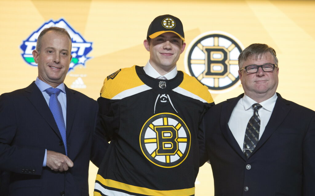 John Beecher, center, was the Bruins first pick in the draft. he will not turn pro for a couple of years, instead heading to Michigan.