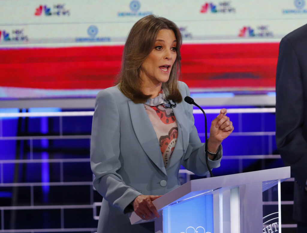Democratic presidential candidate author Marianne Williamson, speaks during the Democratic primary debate hosted by NBC News at the Adrienne Arsht Center for the Performing Art, Thursday, June 27, 2019, in Miami. (AP Photo/Wilfredo Lee)