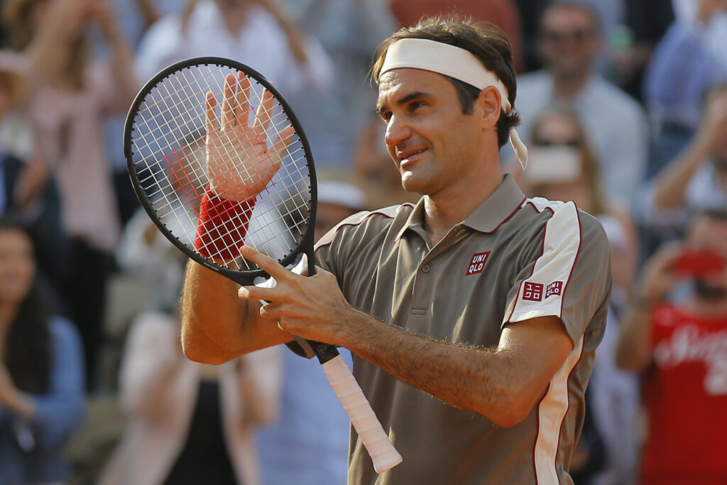 Switzerland's Roger Federer celebrates winning his quarterfinal match of the French Open against Switzerland's Stan Wawrinka in four sets, 7-6 (7-4), 4-6, 7-6 (7-5), 6-4, at the Roland Garros stadium in Paris, Tuesday.